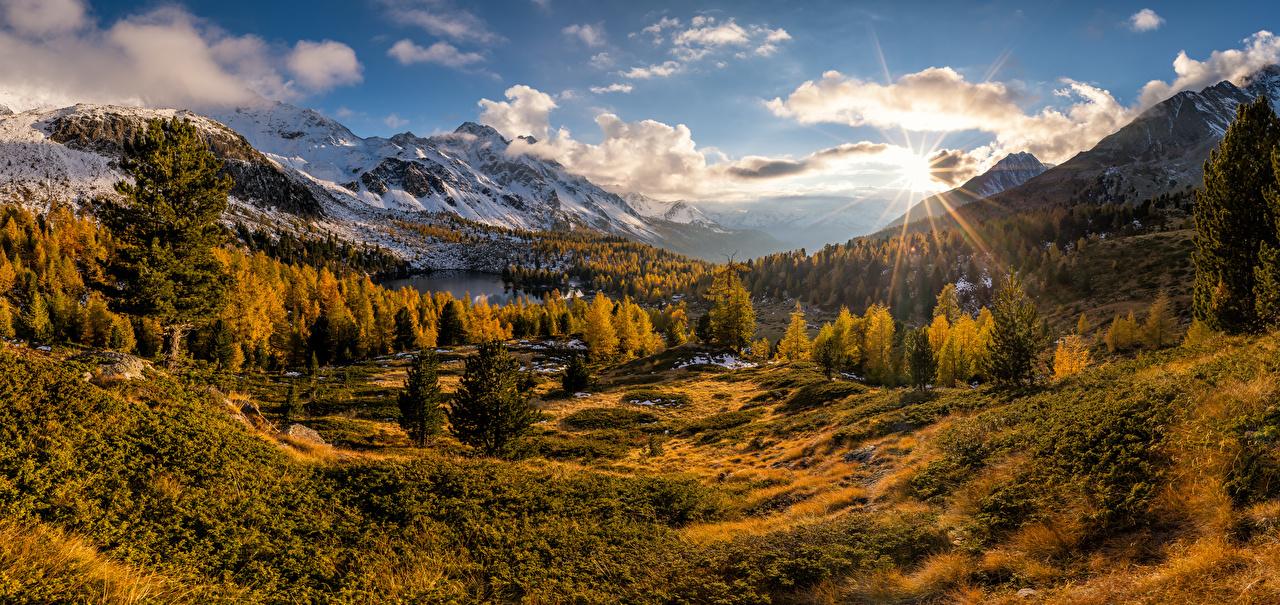 Фотографии альп Швейцария Valdidentro, panorama Горы солнца осенние Природа Небо Пейзаж облачно Альпы гора Осень Солнце Облака облако