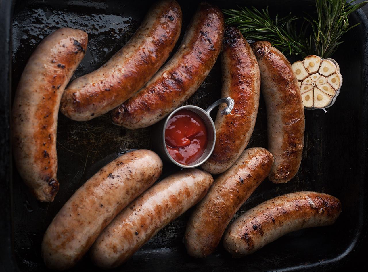Фото Кетчуп Сосиска Продукты питания Крупным планом кетчупа кетчупом Еда Пища вблизи