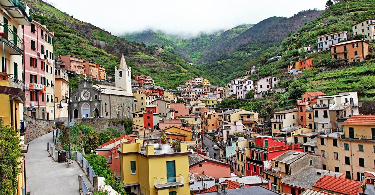 Фото Италия Riomaggiore Холмы Дома Города Здания