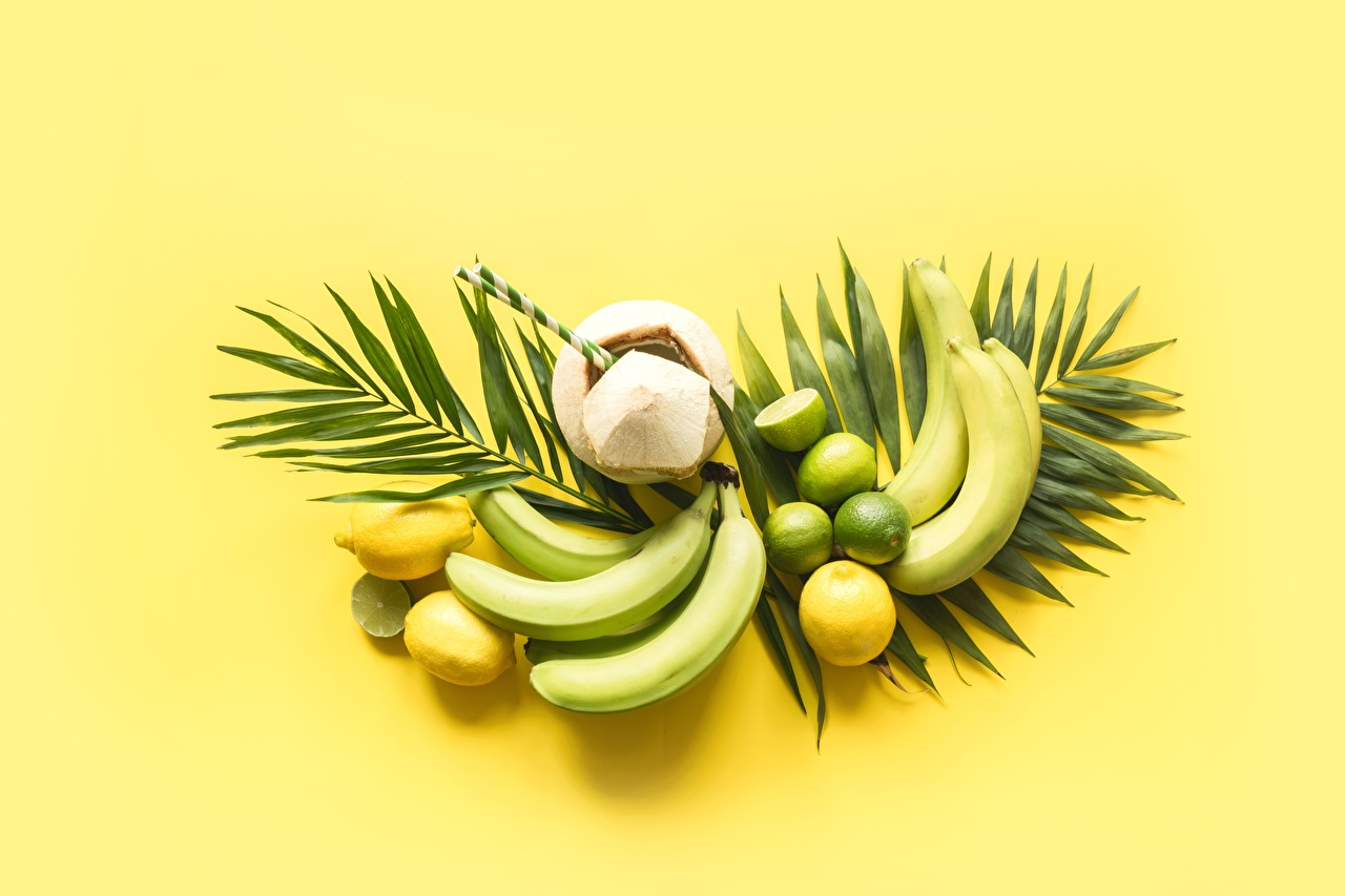 Картинки лист Кокосы Лимоны Бананы Фрукты Продукты питания Цветной фон Листья Листва Еда Пища