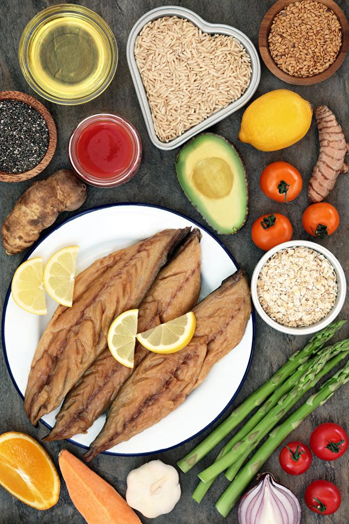 Фотография Рис Помидоры Рыба Зерна Лимоны Авокадо Пища Овощи тарелке  для мобильного телефона Томаты зерно Еда Тарелка Продукты питания