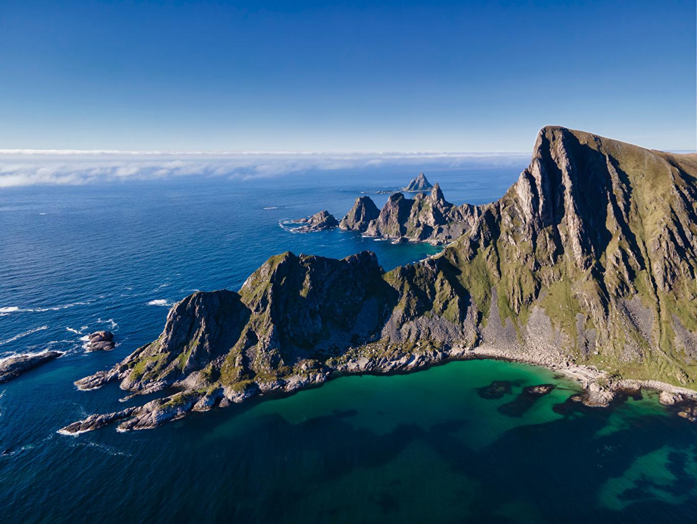 Фотография Лофотенские острова Норвегия Måtinden Море Горы скале Природа Побережье гора Утес Скала скалы берег
