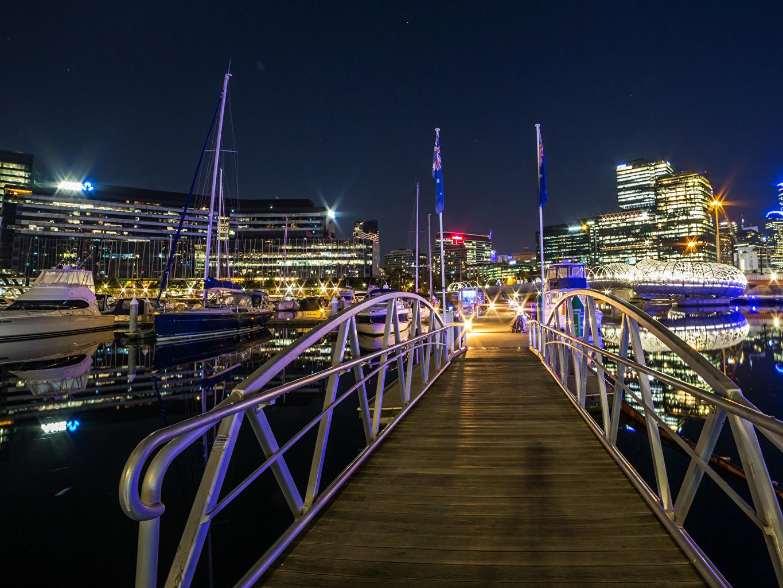 Картинка Лучи света Австралия Melbourne Мосты Вечер Причалы город Здания мост Пирсы Пристань Дома Города