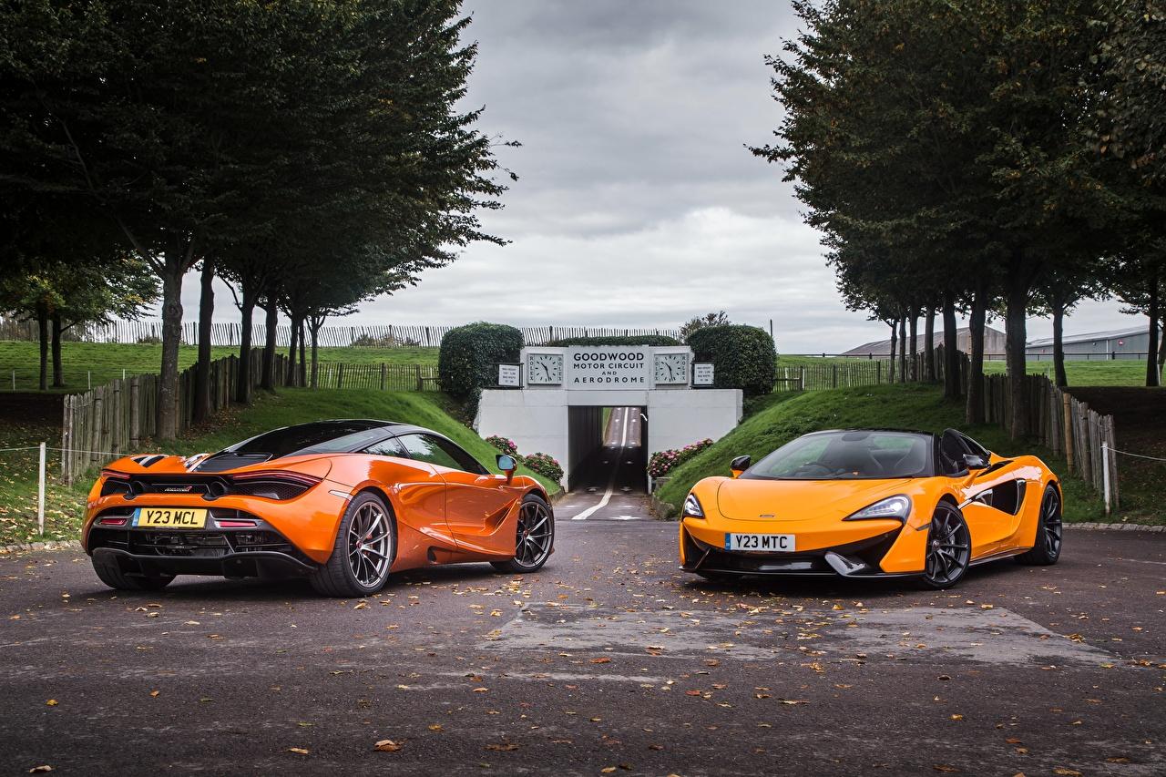 Фотография McLaren Двое Оранжевый Металлик Автомобили Макларен 2 вдвоем Авто Машины
