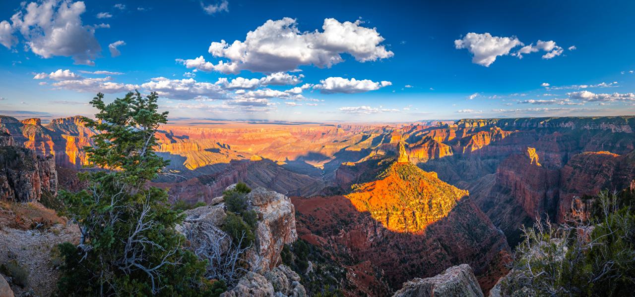 Фотографии Гранд-Каньон парк штаты Панорама Скала каньона Природа Парки Пейзаж облачно США америка панорамная Утес скале скалы Каньон каньоны парк Облака облако