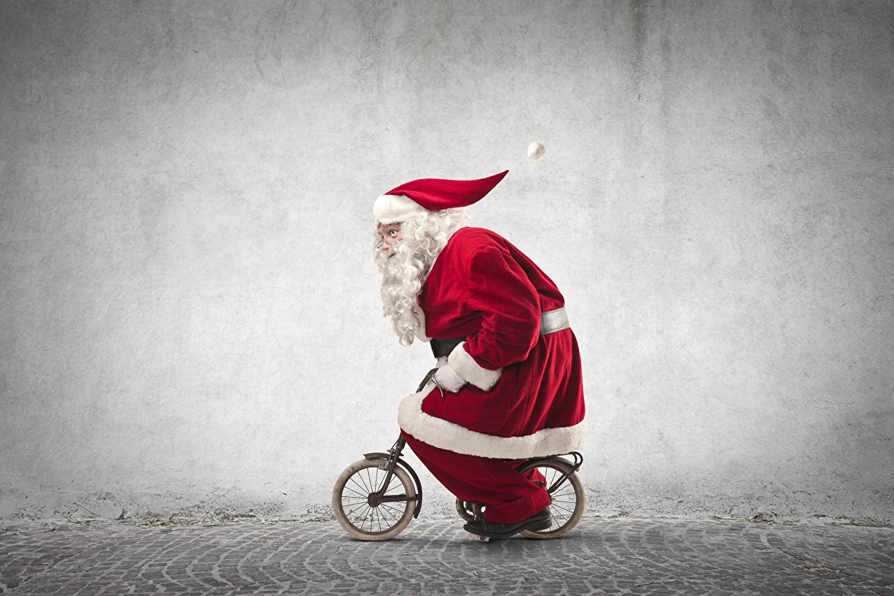 Фотография Рождество Велосипед Санта-Клаус Униформа Праздники Новый год велосипеды велосипеде Дед Мороз униформе