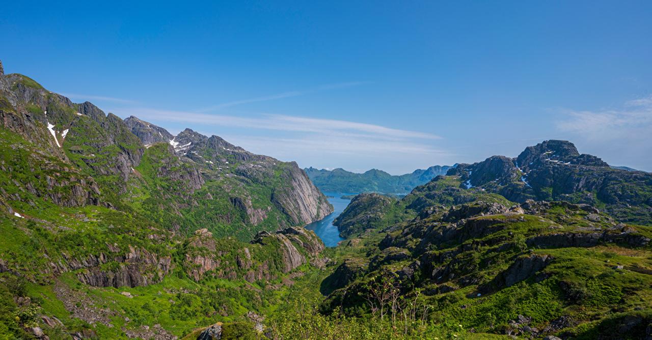 Картинки Лофотенские острова Норвегия Горы скале Природа Небо гора Утес Скала скалы