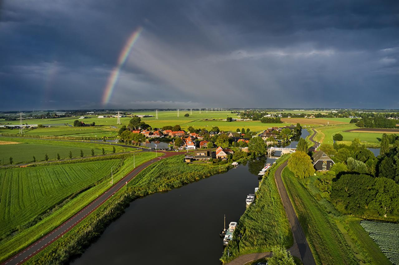 Картинка Нидерланды Rustenburg Тучи радуги Природа Поля Дороги Реки Здания голландия туч Радуга река речка Дома