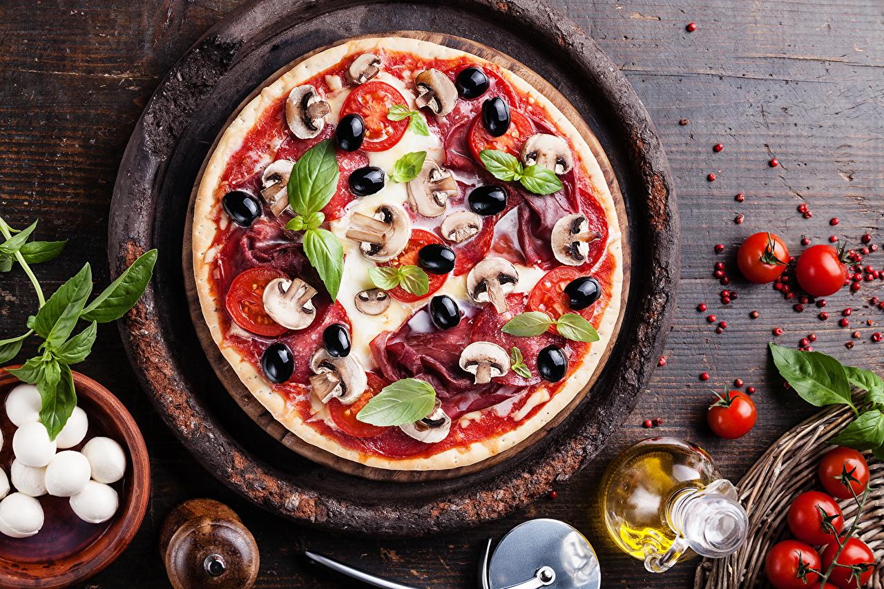Фотография Пицца Томаты Грибы Быстрое питание Еда Помидоры Фастфуд Пища Продукты питания