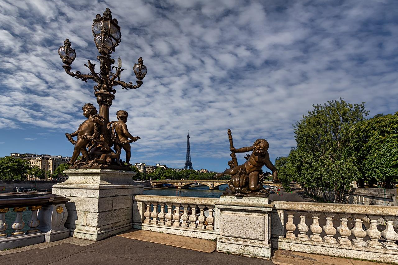Картинка Париж Франция забора Уличные фонари Города Скульптуры париже Забор ограда забором город скульптура