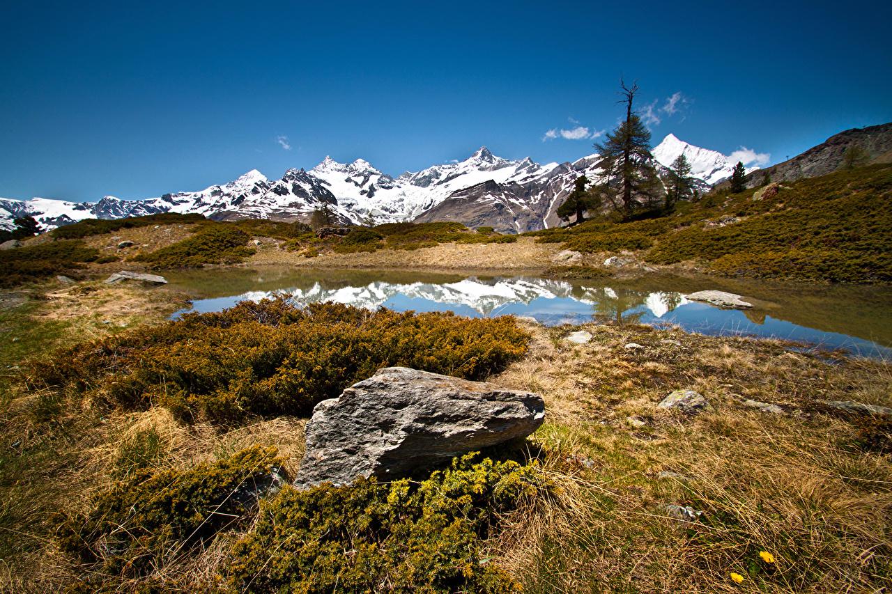Картинки Швейцария Zermatt Горы Природа Озеро Камни гора Камень