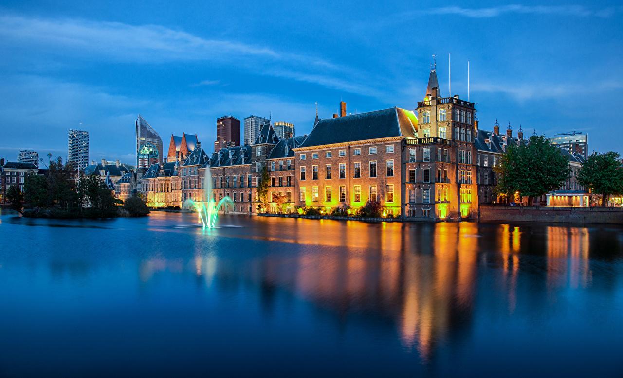 Фото Нидерланды Фонтаны The Hague Вечер город Здания голландия Дома Города