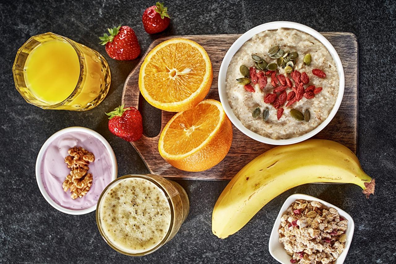 Фотография Смузи Сок Завтрак Апельсин стакане Пища Мюсли Стакан стакана Еда Продукты питания