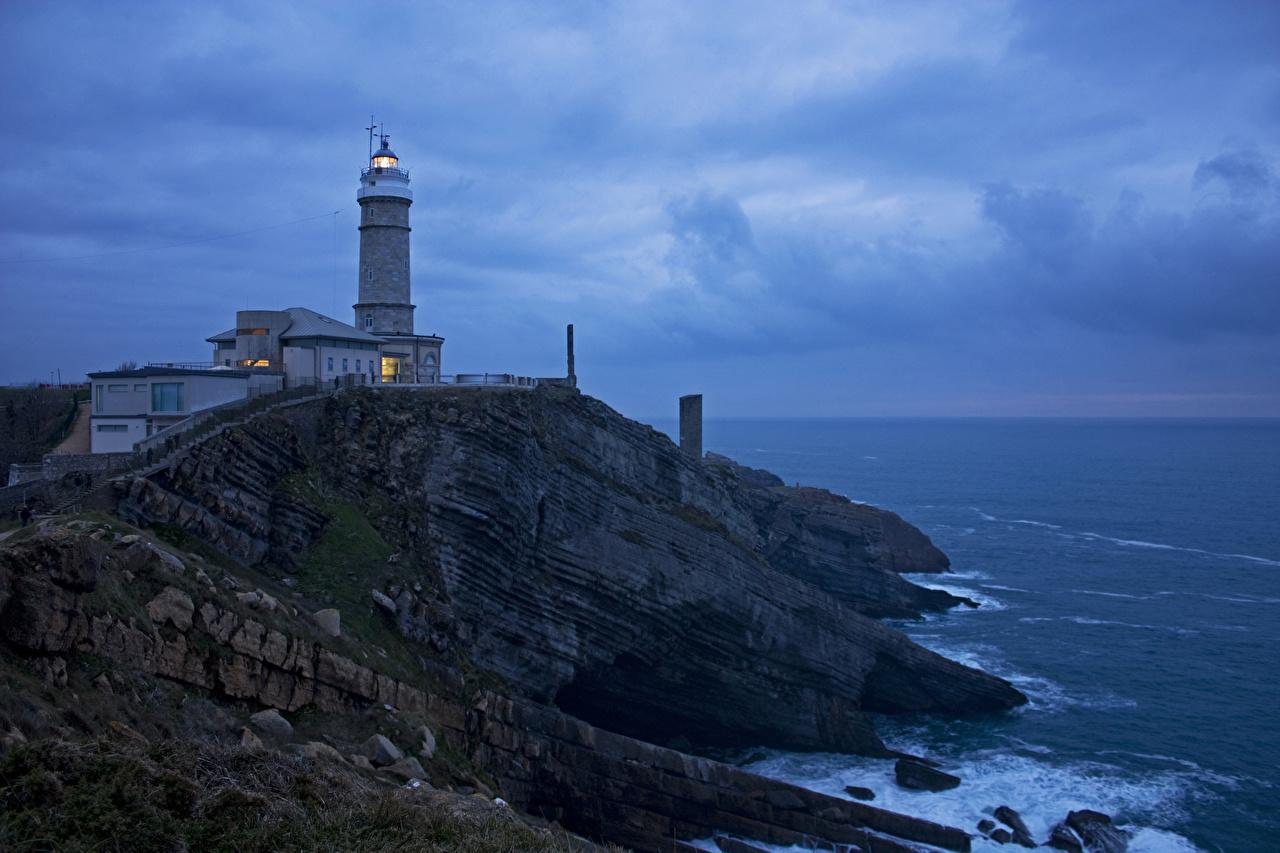Обои Испания Santander Cantabria Маяки Скала Природа Вечер берег Утес Побережье
