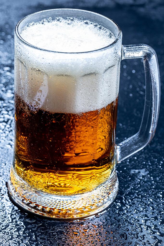 Картинка Пиво пене Кружка Продукты питания вблизи  для мобильного телефона Еда Пена Пища пеной кружки кружке Крупным планом