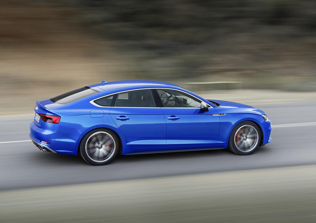 Фотография Audi S5 2018 Drive A5 синих едущая Сбоку машина Ауди синяя синие Синий едет едущий скорость Движение авто машины Автомобили автомобиль