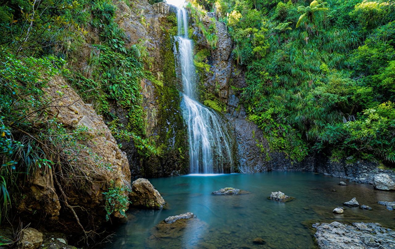 Обои для рабочего стола Новая Зеландия Kitekite Falls Скала Природа Водопады Камень Утес скале скалы Камни