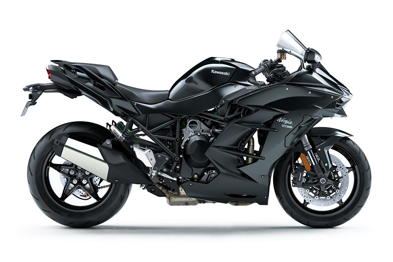 Фотографии Kawasaki Ninja H2 SX, 2018 Черный Мотоциклы белом фоне Кавасаки черная черные черных мотоцикл Белый фон белым фоном