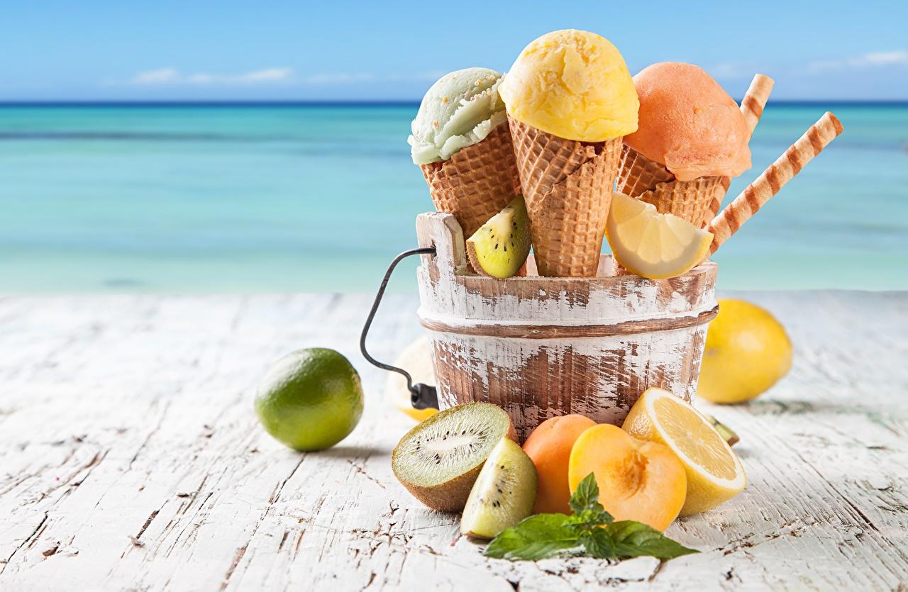 Фотографии Пища Апельсин Мороженое Киви Лимоны Вафельный рожок Цитрусовые Еда Продукты питания