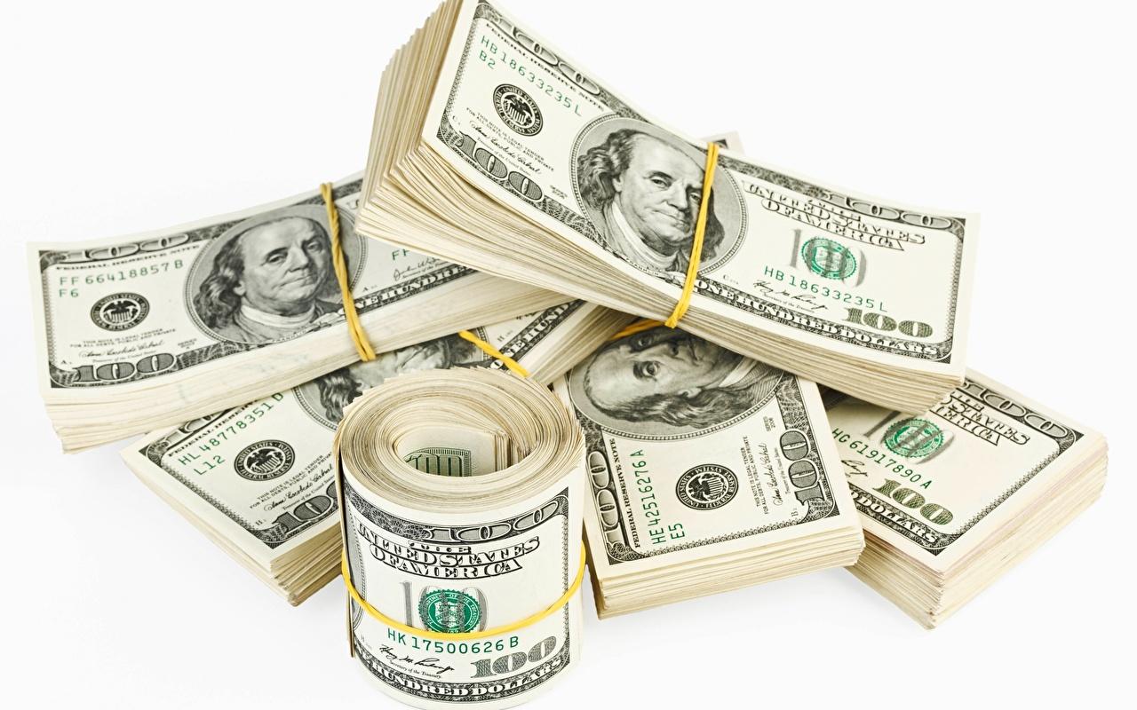 Фотография Купюры Доллары Деньги Белый фон Банкноты