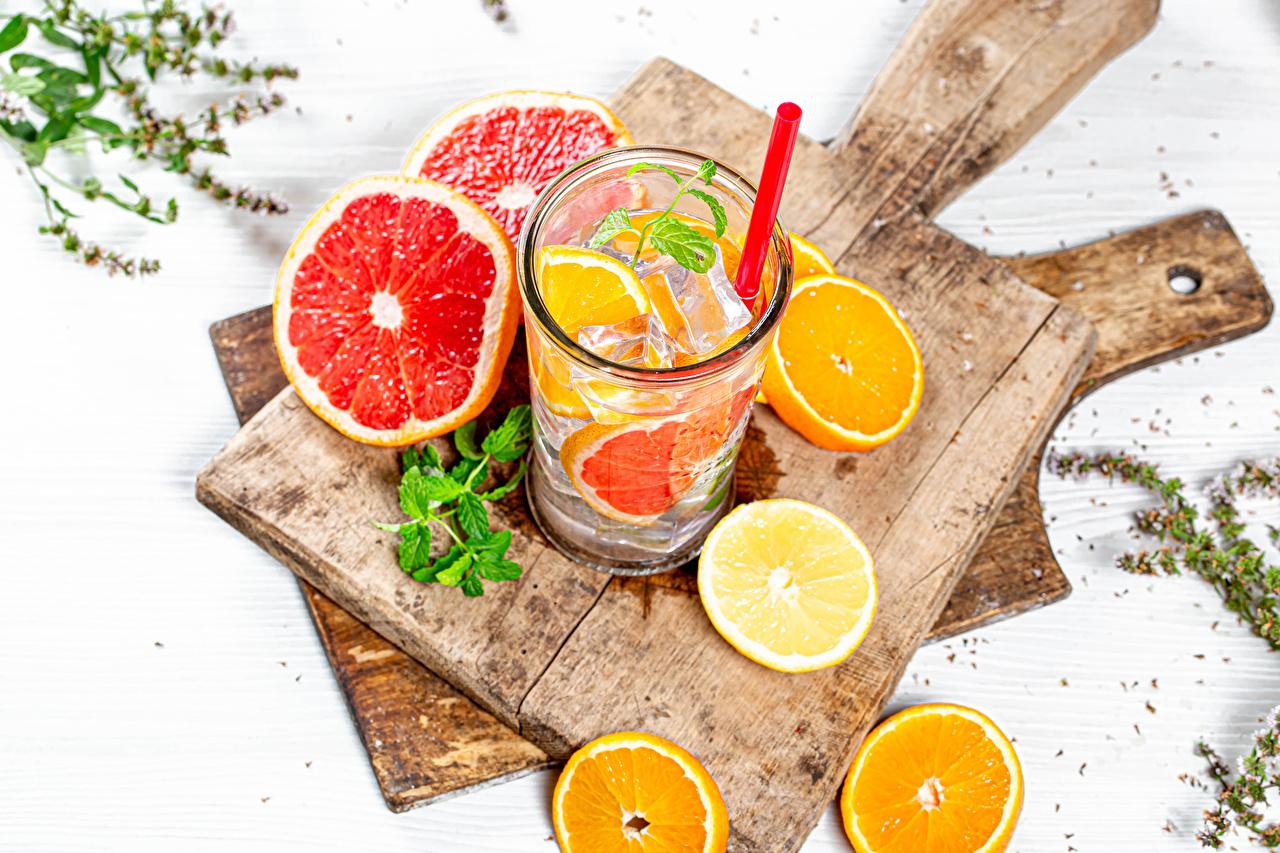 Картинка Лимонад Апельсин Грейпфрут Лимоны стакане Еда Разделочная доска Напитки Стакан стакана Пища Продукты питания разделочной доске напиток