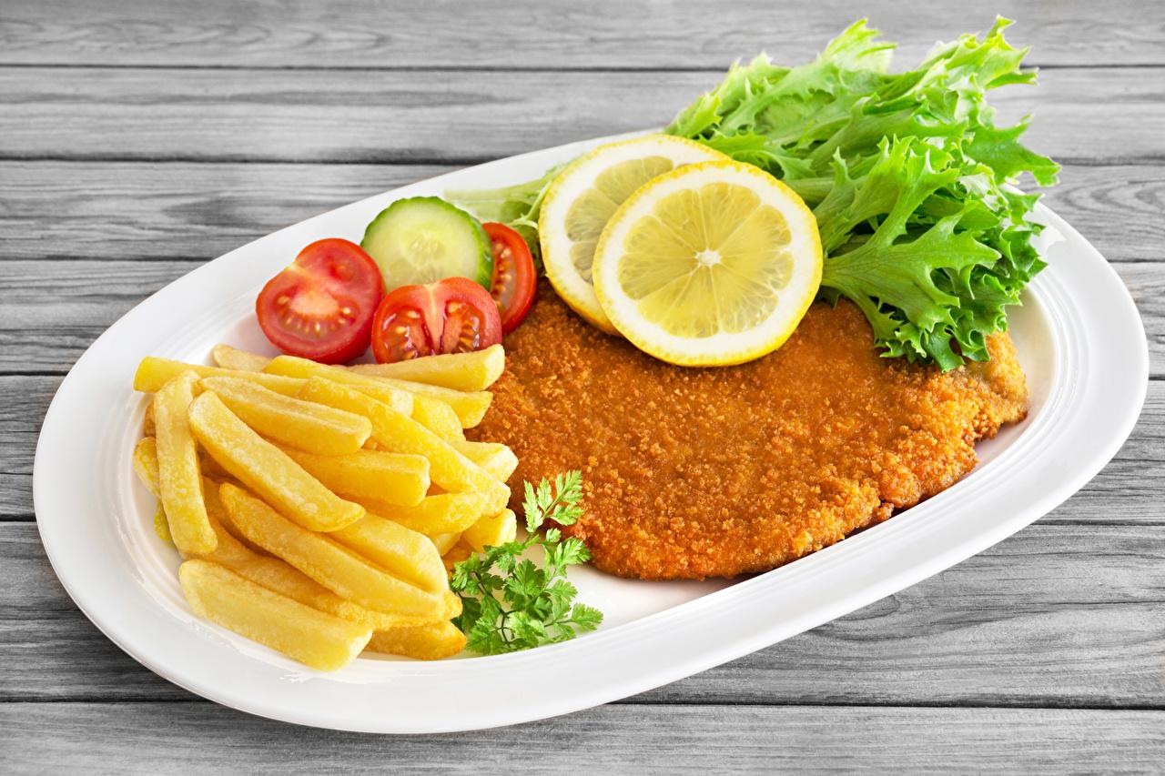 Картинки Картофель фри Лимоны Быстрое питание Еда Еда Овощи Тарелка Мясные продукты Фастфуд Пища Продукты питания