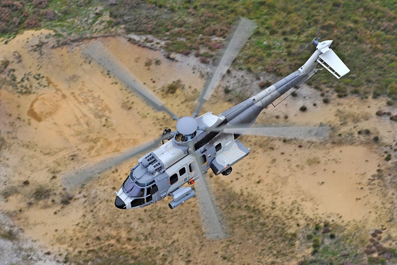 Обои Вертолеты Airbus Helicopters H225M летит Сверху Авиация летят Полет летящий