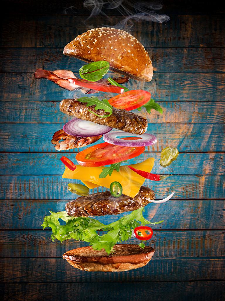 Фото Гамбургер Булочки Быстрое питание Пища Овощи Мясные продукты Доски  для мобильного телефона Фастфуд Еда Продукты питания