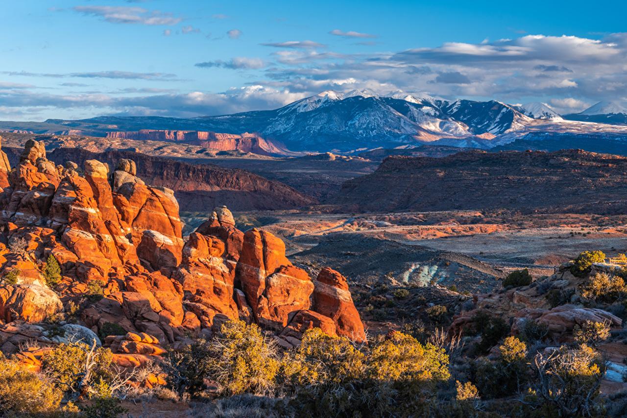 Фото америка Arches National Park, Utah Горы скалы Природа парк Пейзаж облако США штаты гора Утес скале Скала Парки Облака облачно