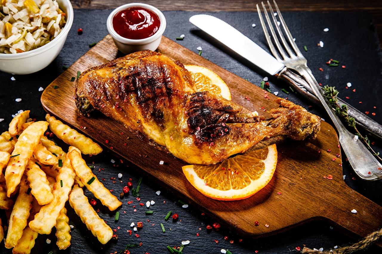 Фотография Апельсин Картофель фри Курица запеченная Пища Вилка столовая Еда вилки Продукты питания