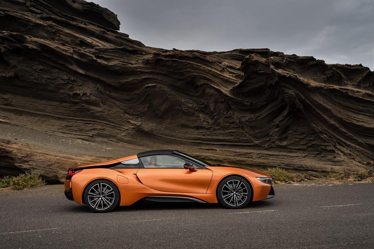 Картинки BMW 2018 i8 Родстер Оранжевый Сбоку машина БМВ оранжевых оранжевые оранжевая авто машины автомобиль Автомобили