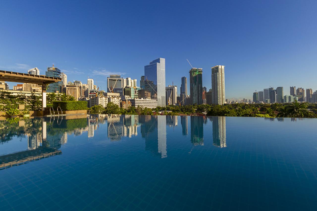 Обои для рабочего стола Филиппины Плавательный бассейн Makati City Дома Города Бассейны город Здания