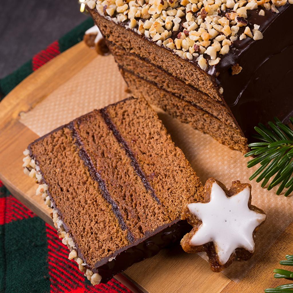 Картинка Новый год Шоколад Торты Кусок Пища Печенье Выпечка Рождество часть кусочки кусочек Еда Продукты питания