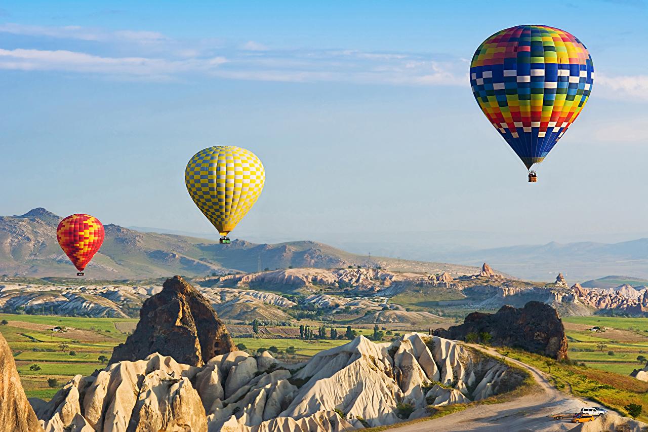 Фотографии Турция Воздушный шар Cappadocia Утес Природа Холмы втроем летящий Аэростат Скала Полет Трое 3
