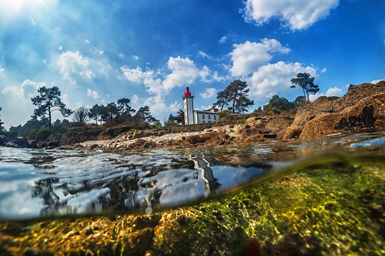 Фотографии Франция Le phare de Sainte-Marine, Odet Маяки Природа Небо воде маяк Вода