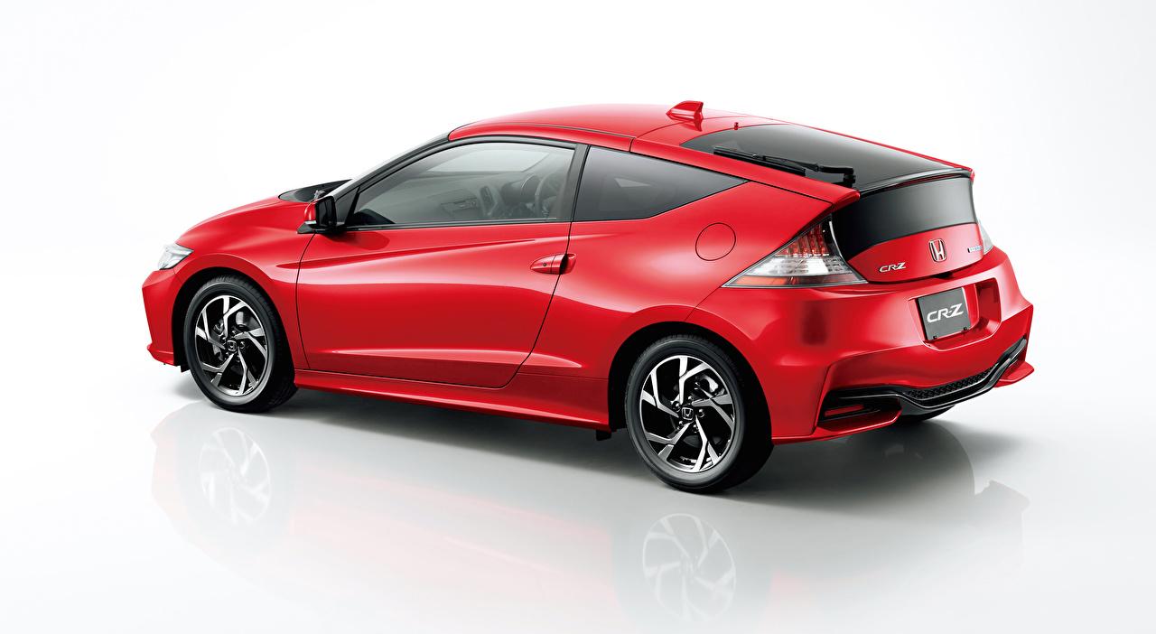 Обои для рабочего стола Хонда CR-Z, Hybrid (2010-2016) Купе Гибридный автомобиль красных Сбоку Автомобили сером фоне Honda красная красные Красный авто машины машина автомобиль Серый фон