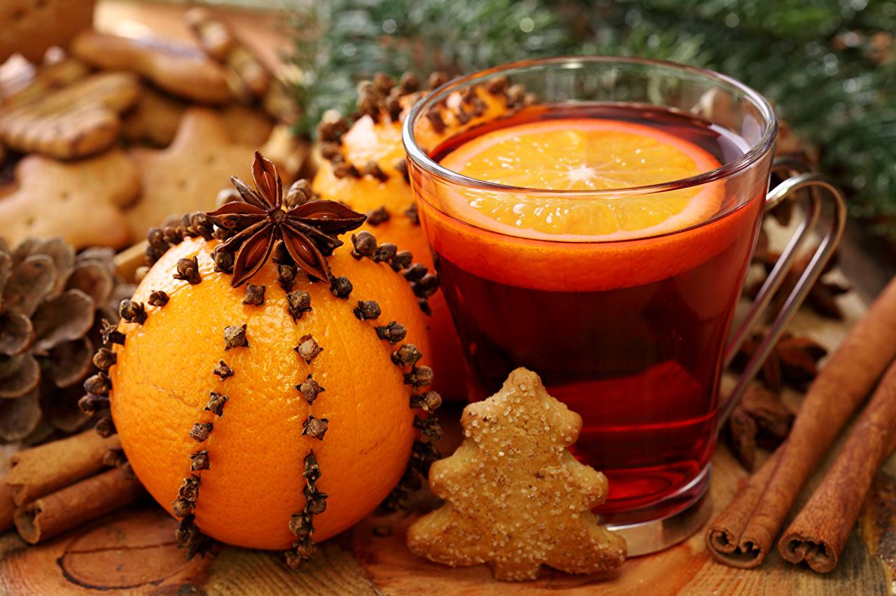 Фотография Новый год Чай Елка Апельсин Бадьян звезда аниса Корица Еда Чашка Печенье Напитки Рождество Новогодняя ёлка Пища чашке Продукты питания напиток