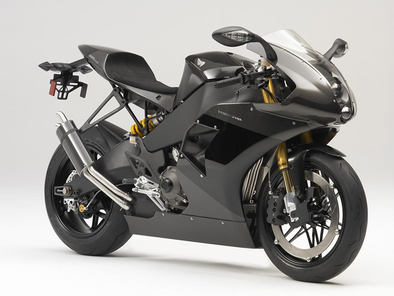 Фотография Карбон 2013-19 EBR 1190RS мотоцикл Сбоку Серый фон карбоновая карбоновый карбоновые Углепластик Мотоциклы сером фоне