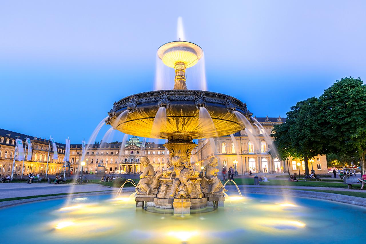Картинки Германия Фонтаны Stuttgart city center Вечер Дома город Скульптуры Здания Города скульптура