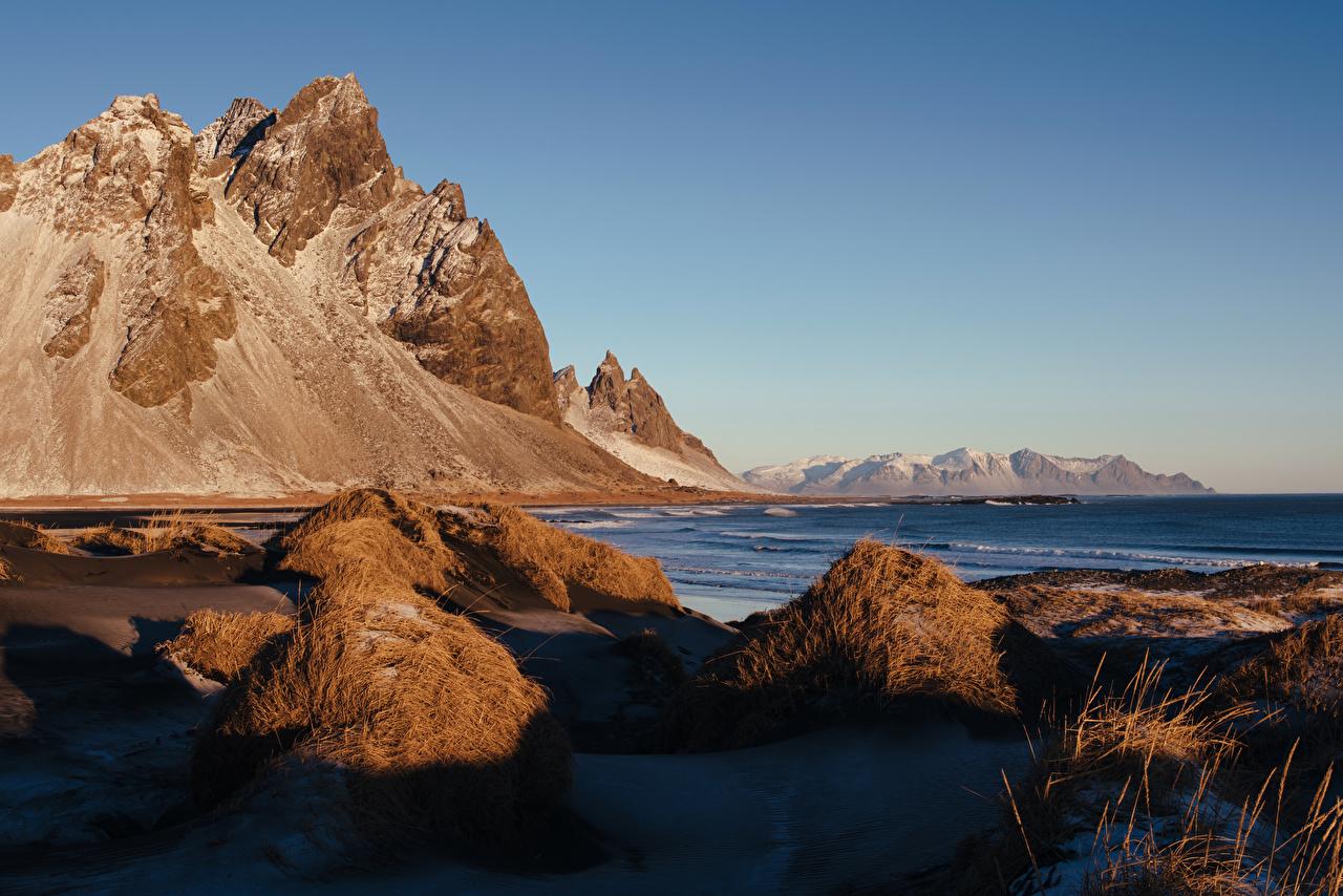 Фотография Исландия Утес Природа Побережье Скала берег