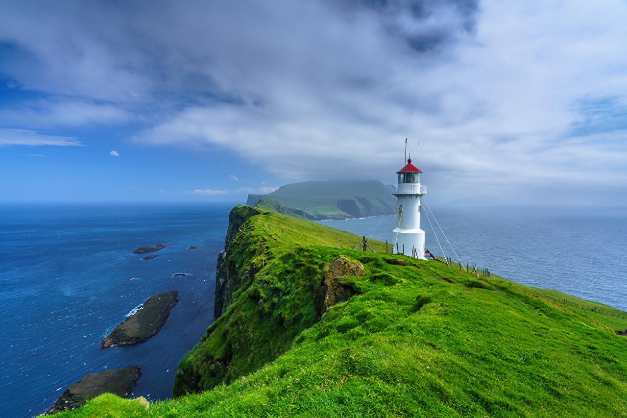 Обои для рабочего стола Дания Holmur Lighthouse, Mykines, Faroe Islands Океан Маяки скале Природа Остров маяк Утес Скала скалы