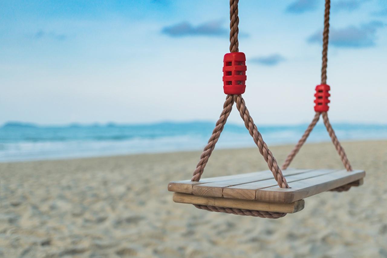 Фотография качелях Размытый фон пляжи вблизи Качели боке Пляж пляжа пляже Крупным планом