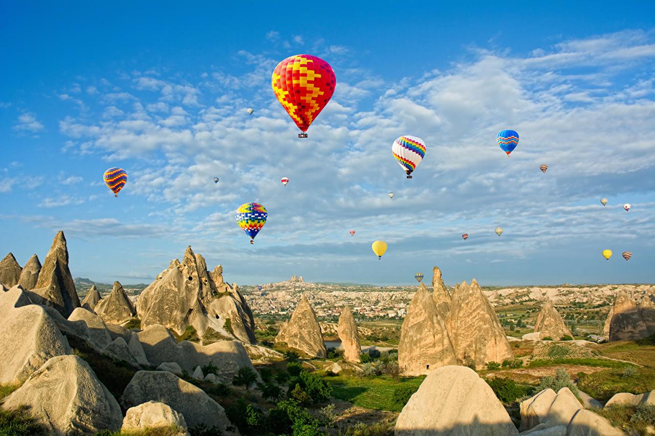 Фотография Турция Воздушный шар Cappadocia Anatolia скале Природа Небо аэростат Утес Скала скалы