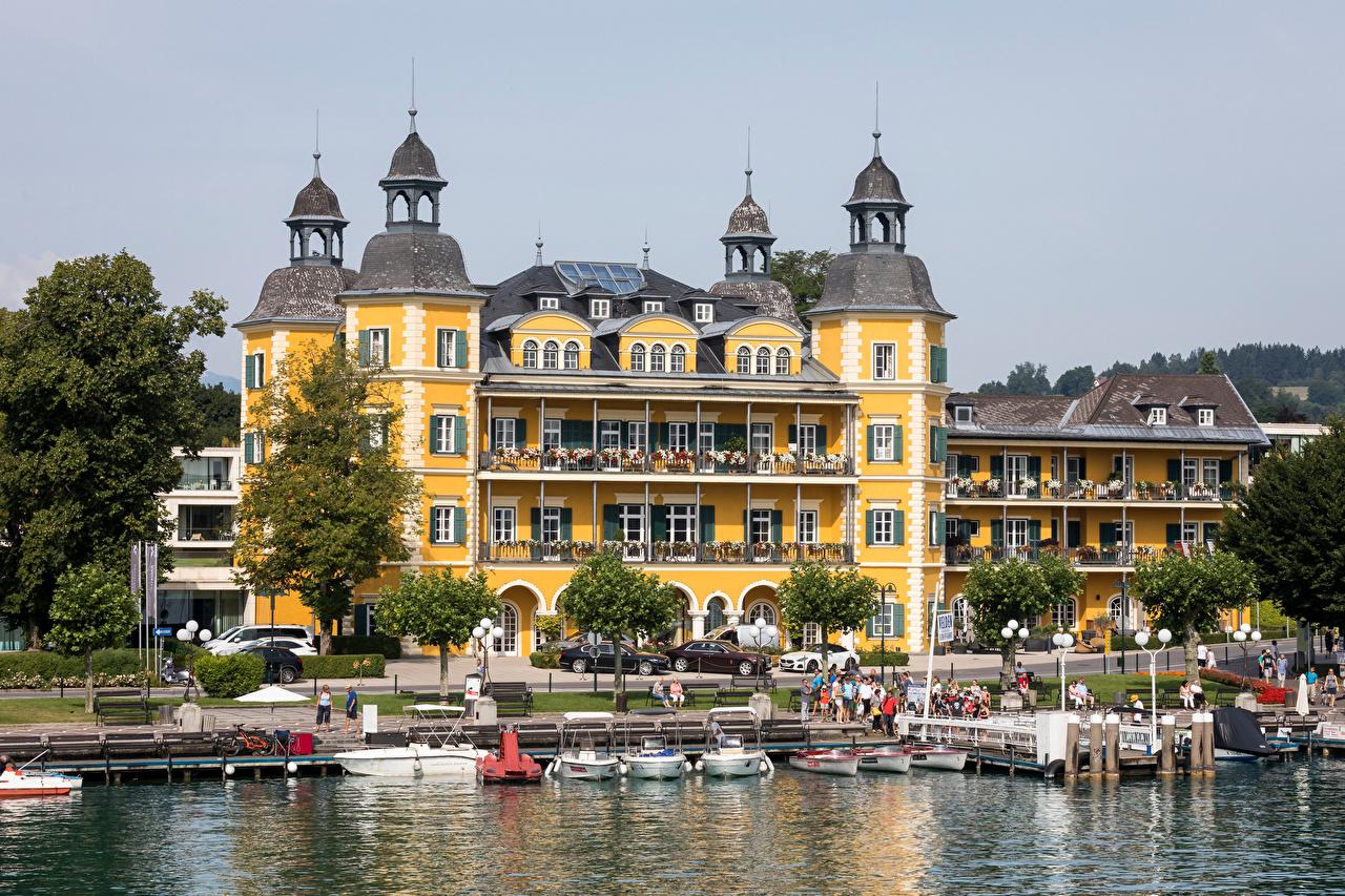 Картинки Австрия Velden, Wörthersee Озеро Лодки набережной город Здания Набережная Дома Города