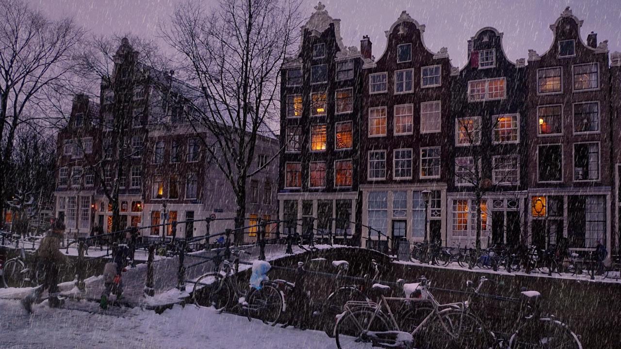 Картинка Амстердам Нидерланды Мосты зимние Снег Города Здания Зима Дома