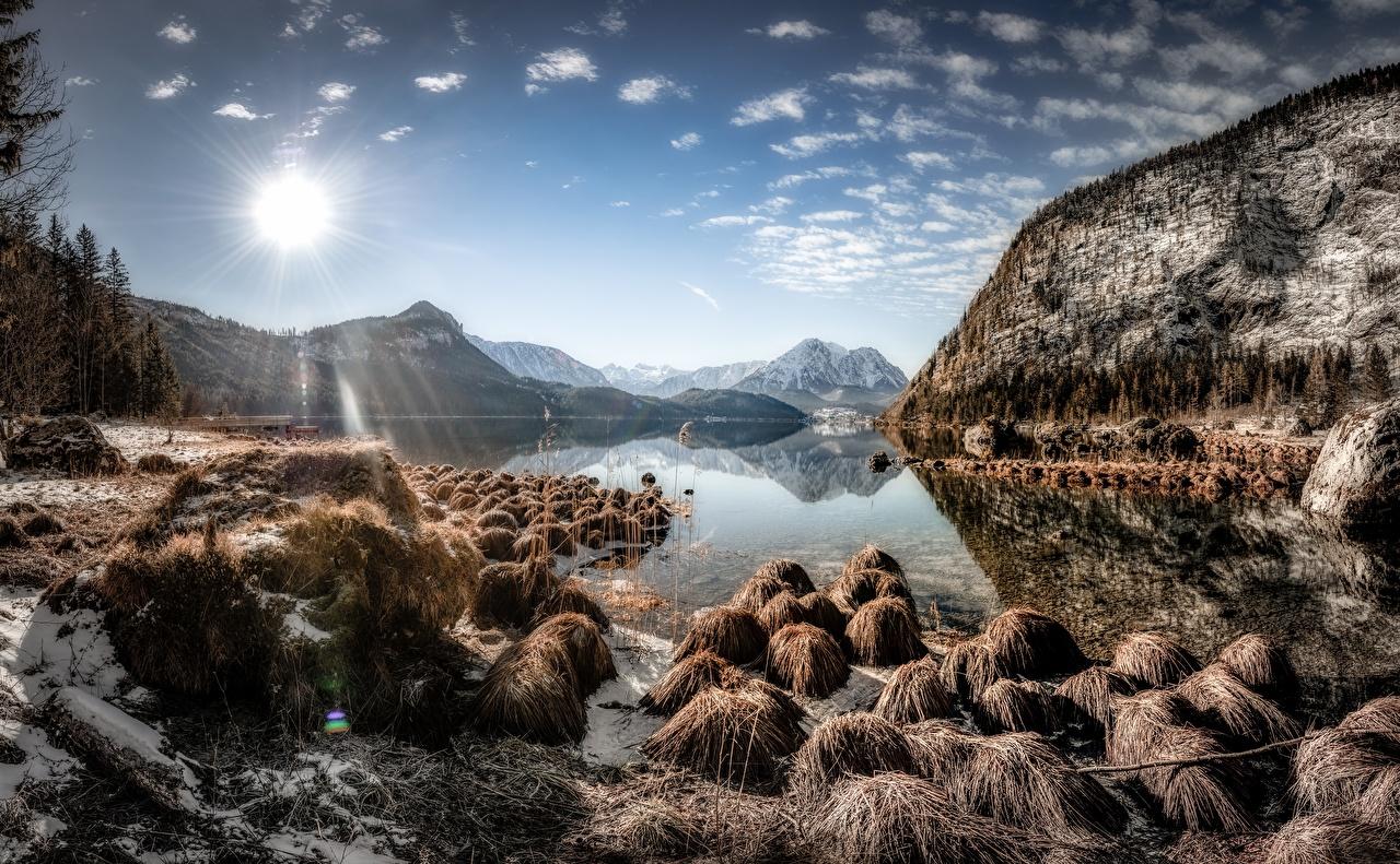 Картинка Австрия Styria, Altaussee гора Солнце Природа Небо Озеро Пейзаж Камень Горы солнца Камни