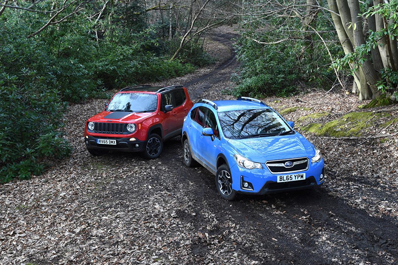 Картинки Джип Субару две красные Голубой Металлик Автомобили Jeep Subaru 2 два Двое вдвоем красная Красный красных голубая голубые голубых авто машины машина автомобиль