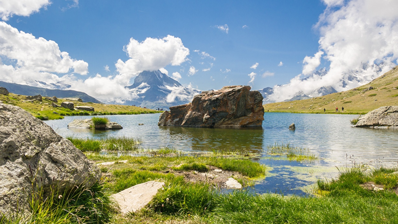 Картинка Швейцария Lake Stellisee Лето Природа Озеро Пейзаж Трава Камни траве Камень