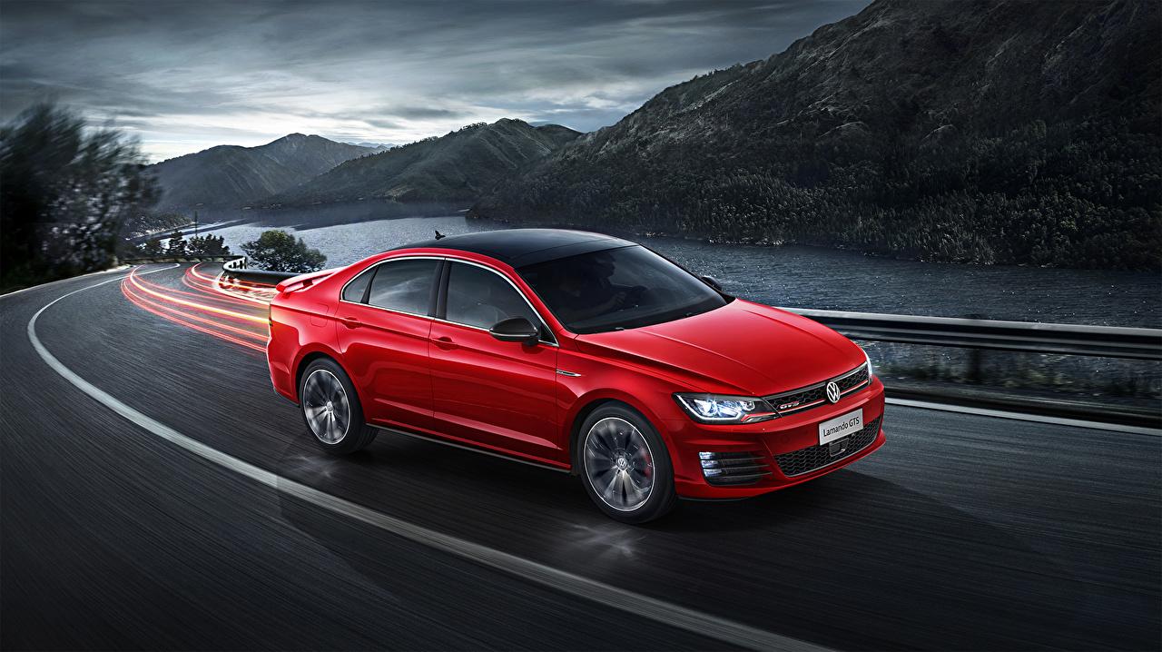 Фотография Фольксваген 2016 Lamando GTS красная Движение автомобиль Volkswagen красных красные Красный едет едущий едущая скорость авто машина машины Автомобили