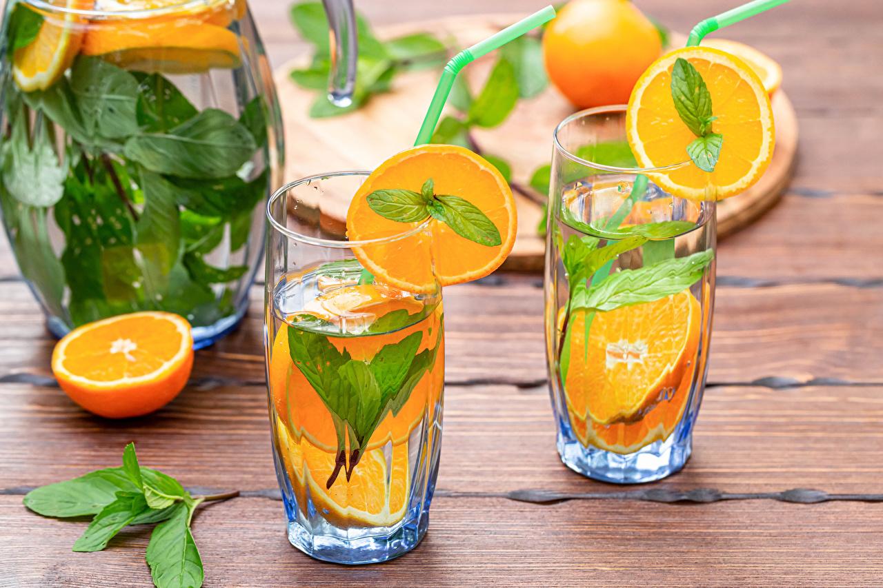 Фото две Апельсин стакане Еда Доски напиток 2 два Двое вдвоем Стакан стакана Пища Продукты питания Напитки
